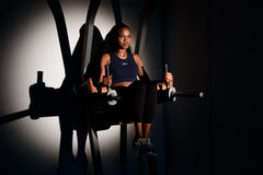 Silhouette of young african-american woman fitness instructor working out at the gym Royalty Free Stock Photography