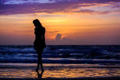 Silhouette young woman Stock Image