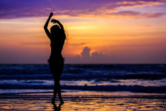 Silhouette young woman. Dancing Stock Images