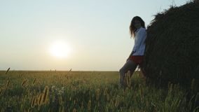 Silhouette of young woman on dusk. Loop stock footage