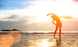 Silhouette Young Woman, Exercise On The Beach At Sunset Royalty Free Stock Photography