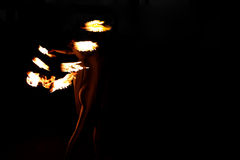 Silhouette of young woman with flames Royalty Free Stock Image