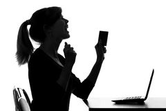 Silhouette of a young woman get bonusefrom an online purchase Royalty Free Stock Images