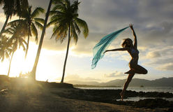 Silhouette of young woman jumping at Las Galeras beach Stock Photo