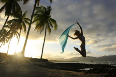 Silhouette of young woman jumping at Las Galeras beach Stock Images