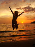 Silhouette of young woman jumping at sunset Royalty Free Stock Photo