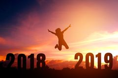 Silhouette young woman jumping to 2019 new year stock images