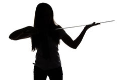 Silhouette of young woman looking at blade Royalty Free Stock Image