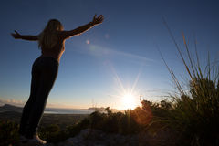 Silhouette of young woman with open arms royalty free stock photography