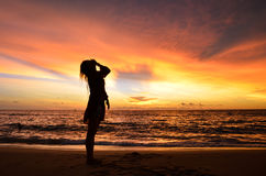 Silhouette of young woman portrait by the sea when sunset Royalty Free Stock Photos