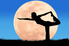 Silhouette young woman practicing yoga Royalty Free Stock Photo
