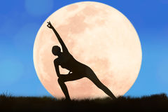 Silhouette young woman practicing yoga Royalty Free Stock Photos