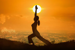 Silhouette young woman practicing yoga Royalty Free Stock Image