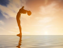 Silhouette young woman practicing yoga at sunset Royalty Free Stock Image