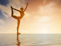 Silhouette young woman practicing yoga at sunset Royalty Free Stock Photography