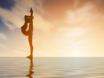 Silhouette young woman practicing yoga at sunset Stock Image