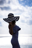 Silhouette of young woman relaxing at the beach Royalty Free Stock Photography