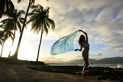 Silhouette of young woman standing at Las Galeras beach Royalty Free Stock Image