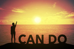 Silhouette young woman standing and raising up her hand about fighting concept at I CAN DO text over a beautiful sunset or sunrise stock photos