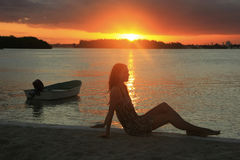 Silhouette of young woman at sunset, Boca Chica bay Stock Images