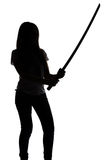 Silhouette of young woman with sword Royalty Free Stock Images