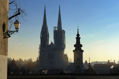 Silhouette of the Zagreb cathedral. And many roofs seen on early winter morning Stock Image