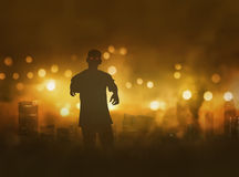 Silhouette of zombie with scary red eyes walking Stock Image