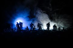 Silhouette of zombies walking over cemetery in night. Horror Halloween concept of group of zombies at night Stock Photography