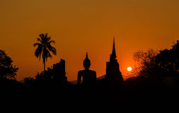 Silhouetteat of Buddha and pagada on sunset time at  Sukhothai H Stock Photo