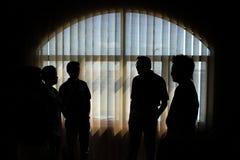 silhouetted люди Стоковые Фотографии RF