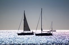 Silhouetted яхты Стоковые Фото