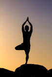 Silhouetted of asian man acts yoga Royalty Free Stock Photo