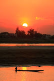 Silhouetted boat on Mekong river at sunset Royalty Free Stock Photo