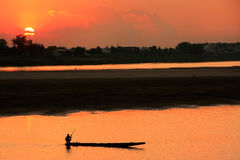 Silhouetted boat on Mekong river at sunset Royalty Free Stock Photos