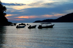 Silhouetted boats Royalty Free Stock Photo