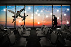 Silhouetted of businessman use mobile phone in airport at sunset Stock Image