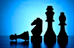 Silhouetted chess pieces Royalty Free Stock Image