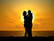 Silhouetted couple at sunset Stock Image