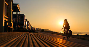 Silhouetted Cyclist At Beach Stock Photos