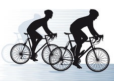 Silhouetted cyclists Stock Photos