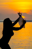 Silhouetted dancer on the beach in Bali Stock Photography