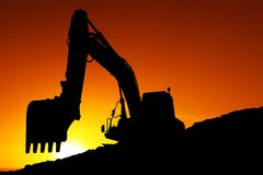 Silhouetted Digging Machine Stock Image