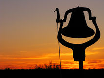 Silhouetted Dinner Bell Stock Photo