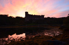 Silhouetted Dunvegan Castle at Sunrise. Beautiful sunrise over silhouetted Dunvegan castle Stock Photos