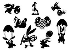 Silhouetted Easter Bunnies in action poses. A series of silhouetted easter bunnies doing all kinds of activities vector illustration