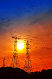 Silhouetted electrical tower Royalty Free Stock Photos