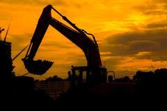 Silhouetted Excavator Stock Photography