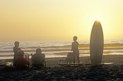 Silhouetted family on the beach Royalty Free Stock Images