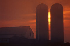 Silhouetted farm building Stock Photography
