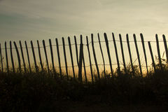 Silhouetted fence against sunset Royalty Free Stock Images